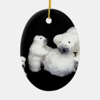 Polar bears family figurines playing with snowball ceramic oval ornament