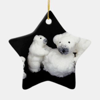 Polar bears family figurines playing with snowball ceramic star ornament