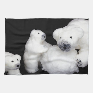 Polar bears family figurines playing with snowball kitchen towel