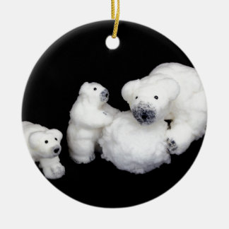 Polar bears family figurines playing with snowball round ceramic ornament