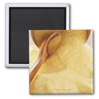 Polenta with wooden spoon and bowl refrigerator magnet