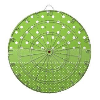 polka-dots on green dartboard