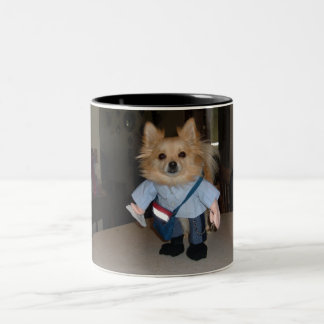 pomeranian in mailman costume Two-Tone coffee mug