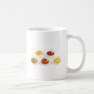 Porcelain bowls and spoons with various spices coffee mug