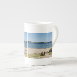 Porcelain cup beach and sea