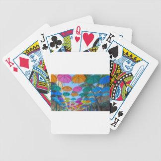 port louis le caudan waterfront umbrellas cap bicycle playing cards