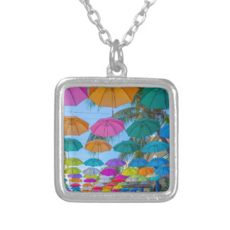 port louis le caudan waterfront umbrellas cap silver plated necklace