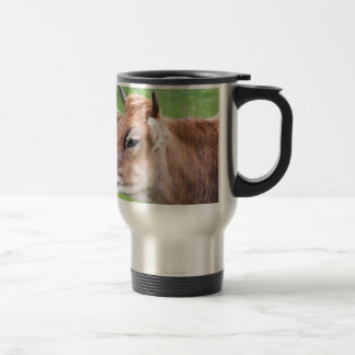 Portrait head of horned brown cow travel mug