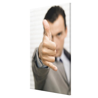 Portrait of a businessman making a thumbs up canvas prints