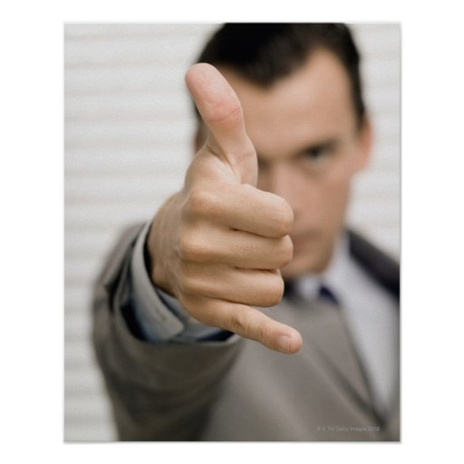 Portrait of a businessman making a thumbs up print