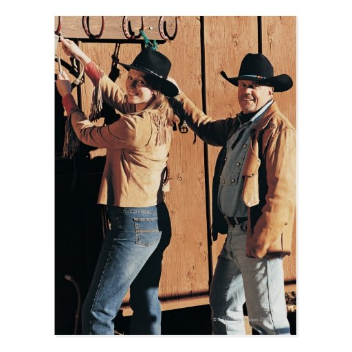 Portrait of a Cowboy and Cowgirl Arranging Reins Post Card