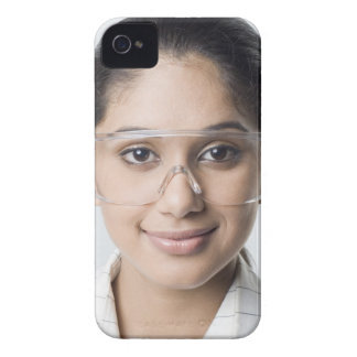 Portrait of a female lab technician wearing a iPhone 4 covers