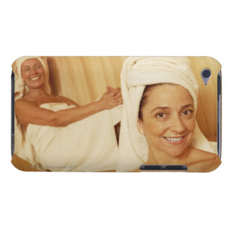Portrait of a mature woman smiling with another iPod touch cases