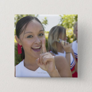 Portrait of a Teenage Cheerleader Holding a 2 Inch Square Button