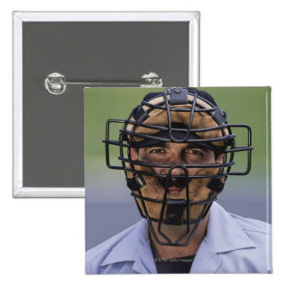 Portrait of baseball umpire wearing protective 2 inch square button