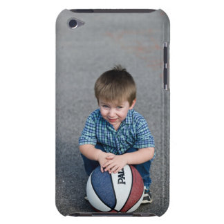 Portrait of boy with basketball outdoors iPod touch case