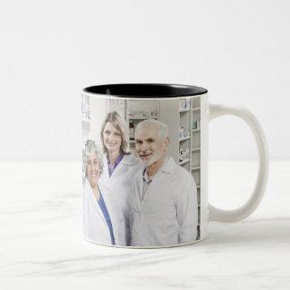 Portrait of four smiling pharmacists Two-Tone coffee mug