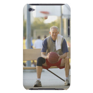 Portrait of mature man with basketball sitting iPod Case-Mate case