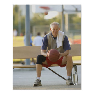 Portrait of mature man with basketball sitting poster