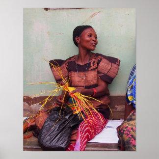 Portrait of pretty Ugandan woman weaving mat Poster