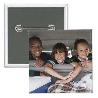 Portrait of smiling children in car 2 inch square button