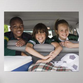 Portrait of smiling children in car poster
