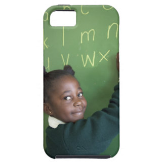 Portrait of smiling schoolgirl writing on the iPhone 5 covers