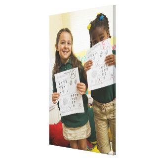 Portrait of two preschool girls with A plus and Canvas Print