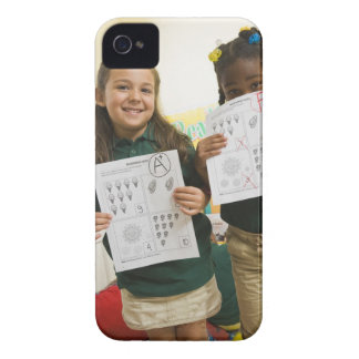 Portrait of two preschool girls with A plus and iPhone 4 Covers