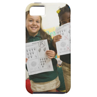 Portrait of two preschool girls with A plus and iPhone 5 Cases