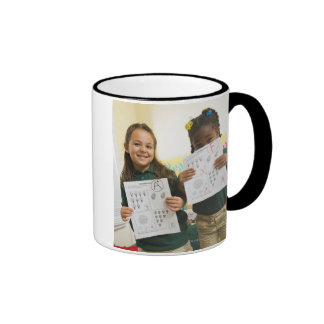Portrait of two preschool girls with A plus and Ringer Mug