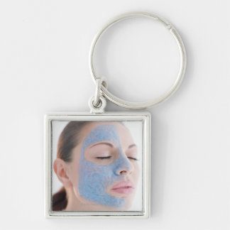 portrait of you woman with one face side covered key chain