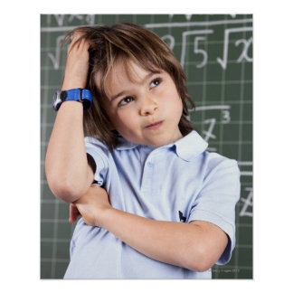 portrait of young boy in classroom in front pof poster