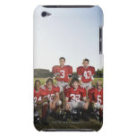 Portrait of youth football team on field iPod touch cases