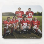 Portrait of youth football team on field mouse pad