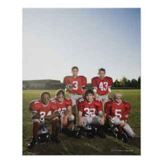 Portrait of youth football team on field poster