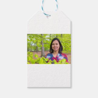 Portrait woman with green leaves in spring gift tags
