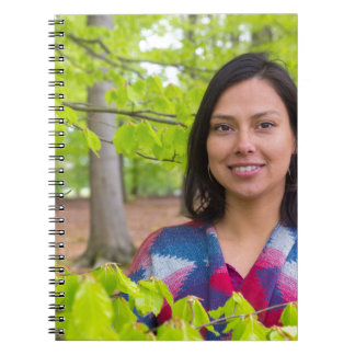Portrait woman with green leaves in spring notebooks