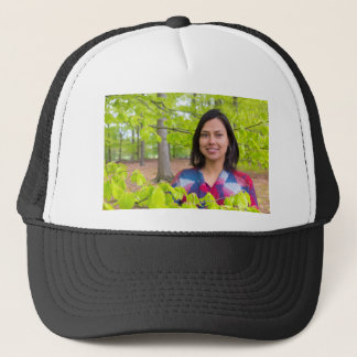 Portrait woman with green leaves in spring trucker hat