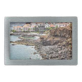 Portuguese coast with sea beach mountains village belt buckle