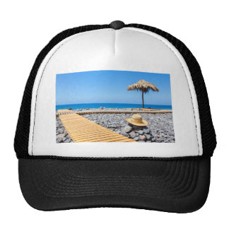 Portuguese stony beach with path sea hat parasols
