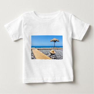 Portuguese stony beach with path sea hat parasols baby T-Shirt