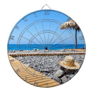 Portuguese stony beach with path sea hat parasols dartboard