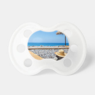 Portuguese stony beach with path sea hat parasols pacifier