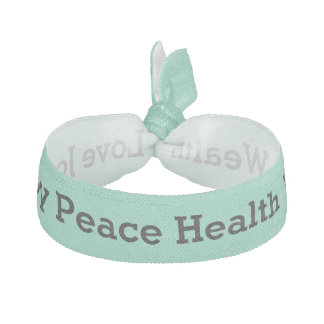 Positive word affirmations black on mint hair tie