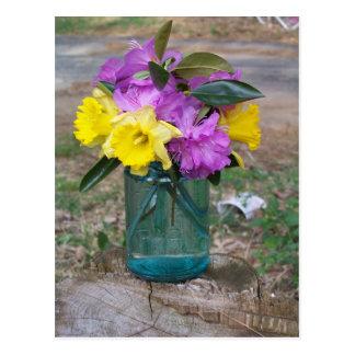 Postcard a bouquet of flowers in a blue jar