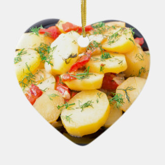 Potatoes with onion, bell pepper and fennel ceramic heart ornament
