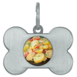 Potatoes with onion, bell pepper and fennel pet name tag