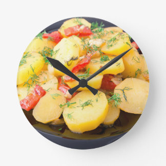 Potatoes with onion, bell pepper and fennel wall clocks