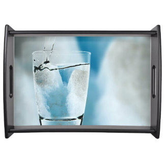 Pouring Pure Glacier Water Into Glass Serving Tray